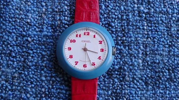 Raketa Russian mechanical watch  White dial with red markers and silver hands Dimensions in mm : width/length/thickness 41/41/13  Second hand central  NEW Crystal  17 jewels Russian mechanical Movement Blue hard plastic case NEW red leather band. Comes without box Overall cosmetic condition on a scale of 1 (worn away) - 10 (immaculate) : 8 Subjective : Im in love. What do YOU think?