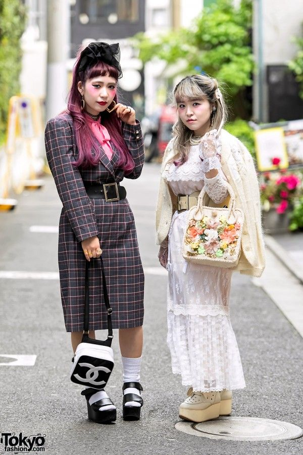 Tamachan and Yun are two vintage-loving girls we met on the street in Harajuku. Their styles appear to be dolly or cult party inspired. Tamachan – on the left with pink hair and bangs – is wearing a vintage plaid dress with a wide belt, a vintage quilted Chanel bag, and platform sandals. Accessories include a black lace hair decoration, heart earrings, and tattoo necklaces. Tamachan's favorite shop is the Tokyo vintage boutique San-biki no Koneko and she is active on Instagram. Yun – on the…