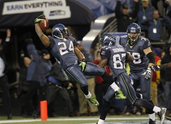"""My brother demanded I put this picture on here.  """"The Run"""" Marshawn Lynch in the 2011 playoffs against the New Orleans Saints.  A must see if you're a Hawks fan!"""