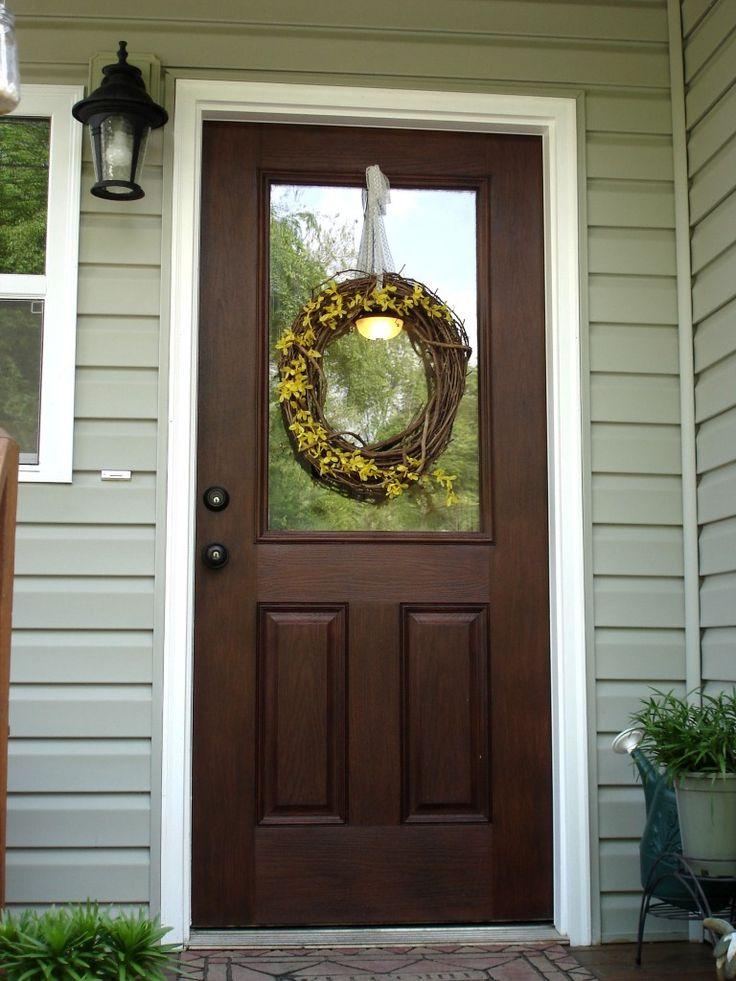 I've been wanting to paint my front door, but I didnt' know what color.  I do now!  Must try this faux wood finish!