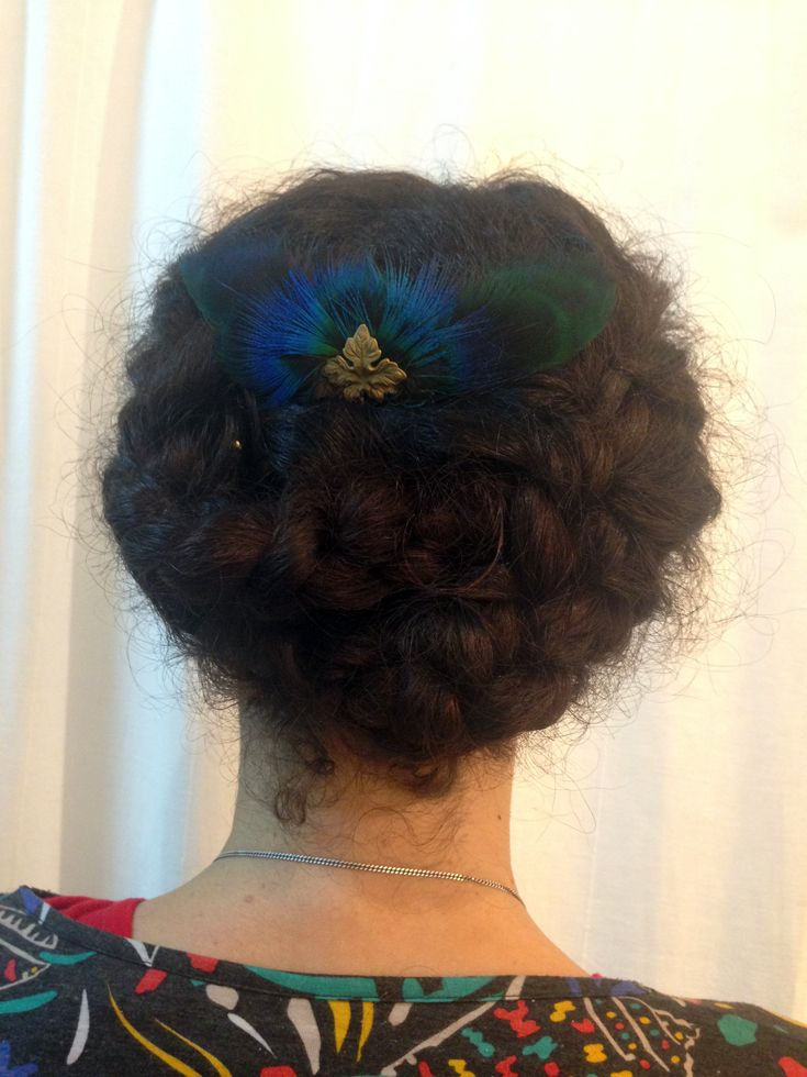 Leti. Peacock feathers and brass comb.