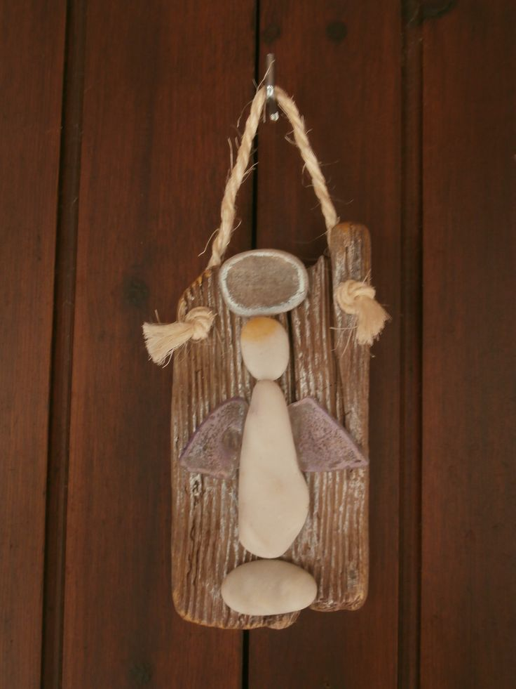 Wall hanging driftwood base with angel made from pebbles & sea glass