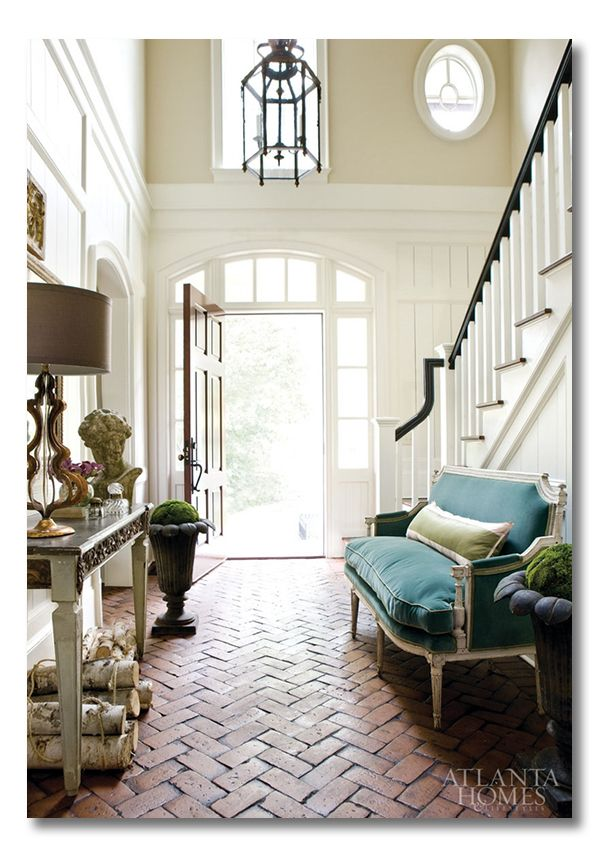 Soaring architecture define this foyer. Learn how to bring these elements into your home! #MustFollowInteriorDesigners