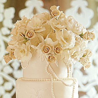 Finally, a beautiful buttercream cake, with a burst of flowers on top.  Cake by Sylvia Weinstock Cakes.