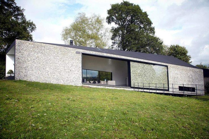 My second favourite house on Grand Designs - beautiful flint faced facade with amazing glass sliding door - shown on Grand Designs UK