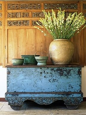 Gorgeous antique rice chest and antique carved wall panel from Indonesia. Visit gadogado.com to view our collection of Indonesian furniture and home accents.