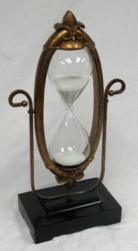 antique hourglass ,.. Thinking of having pictures put in a hour glass for our unity sand set !! Pretty Awesome idea for our wedding!! .. now to find where i can this done at !! ??!: