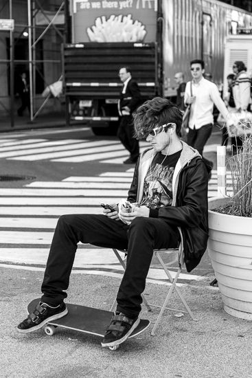 New York... The life on the Phone Photo by Andrea Crupi