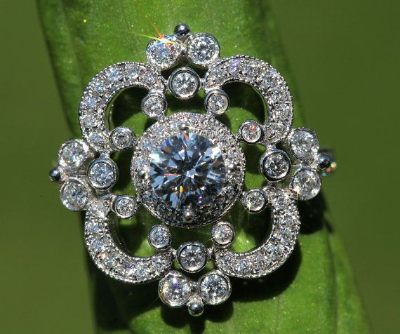 This would be gorgeous in rose gold! 14k white gold Floral Round Diamond Engagement by BeautifulPetra, $2800.00