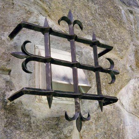 Jozef Custom Ironworks | Iron, Bronze, Curved Stair Railings, Spirals, Gates, Forged iron grating, beautiful blacksmithing craftsmanship. Black paint finish.