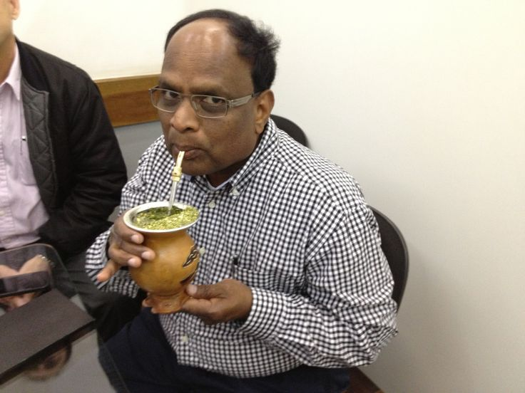CEO, Raju Boligala, enjoying a freshly brewed gourd of Yerba Mate from our Yerba Mate suppliers in Brazil.