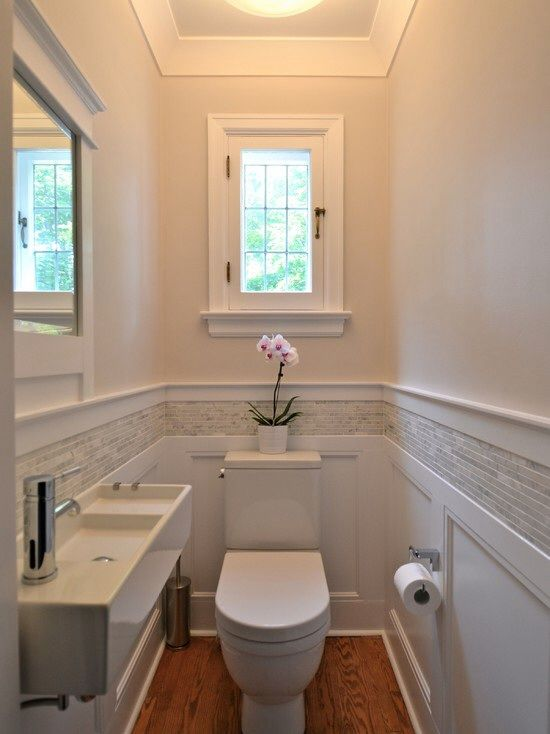 Tiny bathroom with lillangen sink (ikea).  Pretty woodwork and tile.  New favorite bathroom, but I would add modified RAST dresser(s) under sink for storage, since even my bathroom will be slightly wider than this.