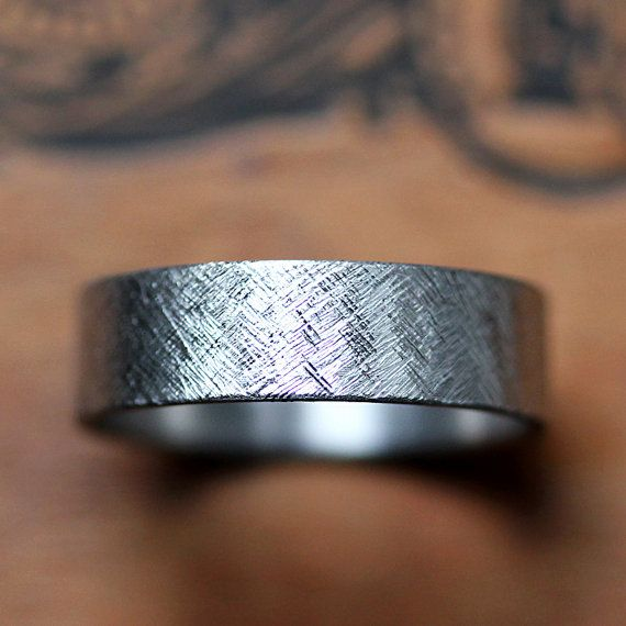 This unique palladium wedding band is finished with a rustic texture giving a modern yet organic look to this ring. Palladium is a gorgeous, lightweight and durable metal. Its unique, special, different. The band has slightly rounded inside edges and is thin (1mm) so its comfortable to wear.  This band is 6mm wide and available by special order only, it will take me about 4 weeks to make for you. I can make this ring in other widths, please contact me for pricing in other widths. Since this…