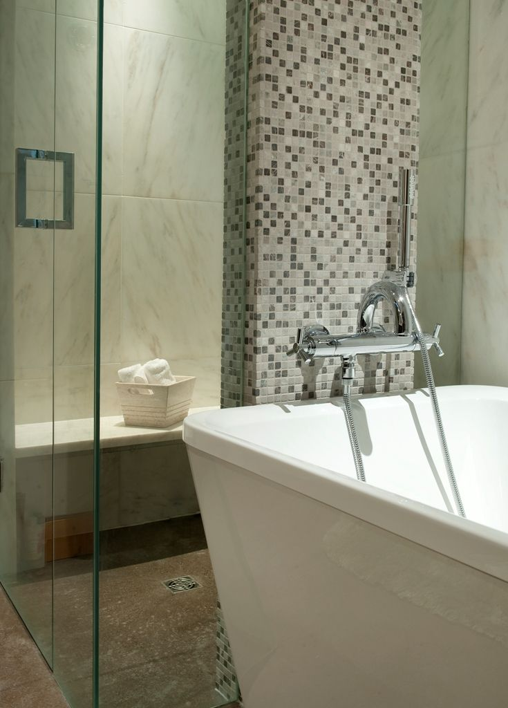 Master Bathroom with steam shower and deep soaker tub - highlighting the intricate tile work within the home.