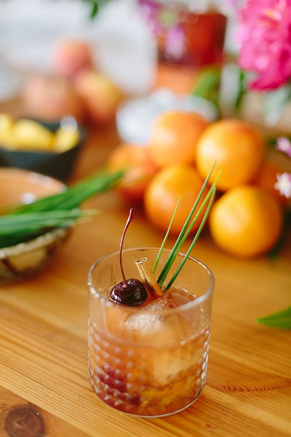 peach smash cocktail: one slice of ripe peach, Luxardo Cherries, ginger simple syrup, candied ginger, bourbon, Orange Bitters