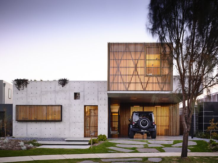 A two-story luxury home designed by Auhaus Architecture is a beautiful collaboration of concrete, marble and brass, located in Torquay, Victoria, Australia.