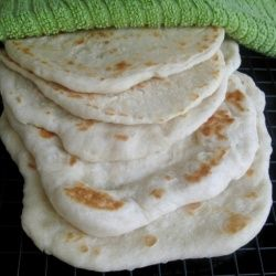 Soft, chewy flatbread – pocketless pita bread – perfect for dipping in hummus or…