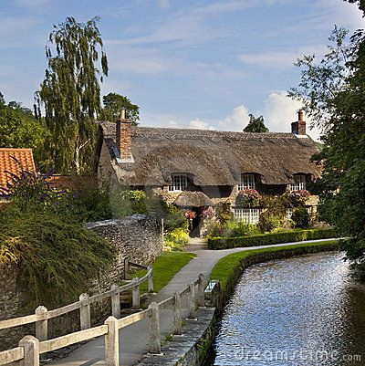 A thatched cottage in the English country village of Thornton-le-Dale in North Yorkshire in the United Kingdom.