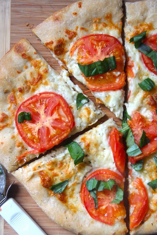 Perfectly simple tomato margherita pizza. Light, fresh, and perfect!