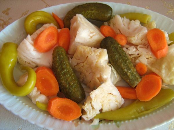 """TURŞU-pickle made with brine, usually with the addition of garlic. It is often enjoyed as an appetizer. It is made with a large variety of vegetables, from cucumber to courgette. In the towns on the Aegean coast, the water of turşu is consumed as a drink. It comes from the Persian """"Torshi"""", which refers to pickled """"Torsh"""" (sour) vegetables."""
