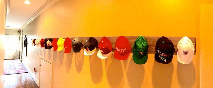 Perfect idea, for an otherwise uninteresting hallway, to display a baseball hat collection.