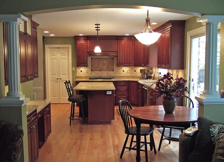 Between Family Room And Kitchen Arched Divider With Columns