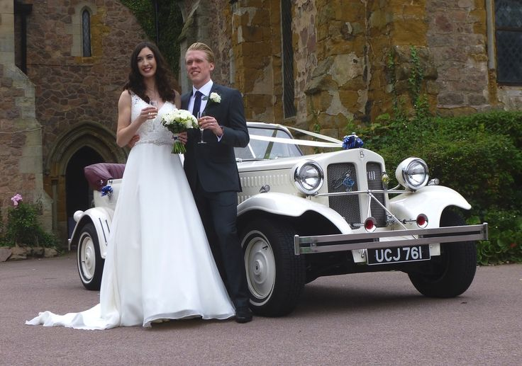 Holly and Lewis enjoying a toast prior to a drive around the village of Rothley in our Beauford Wedding Car