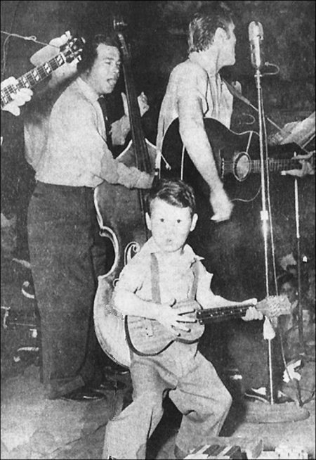 """April 30, 1955 Elvis performed at the Louisiana Hayride, from the Gladewater, Texas, High School, where his performance of Tweedle Dee was recorded for this remote broadcast. A highlight of the show was the appearance of Royce Hanson of Tyler, 3 1/2 year old """"Elvis Presley, Jr."""""""