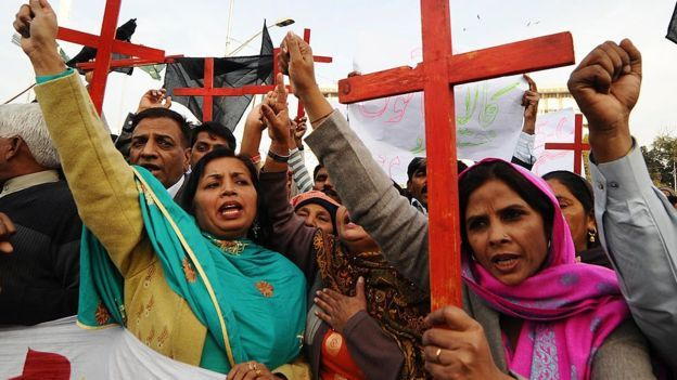 Members of the Pakistan Christian Democratic alliance march during a protest in Lahore on 25 December 2010 in support of Asia Bibi