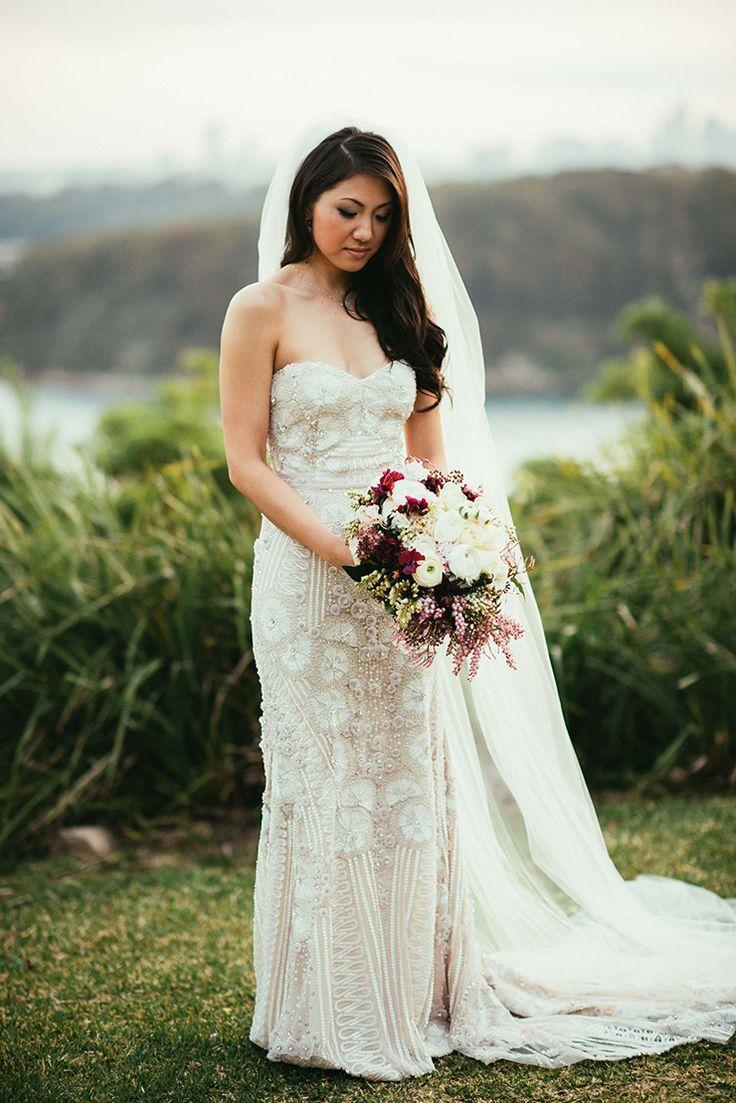 Elegant beaded Naeem Khan NYC wedding dress with burgundy bouquet | This Beautiful Moment Photography | See more: http://theweddingplaybook.com/elegant-candlelit-burgundy-wedding/