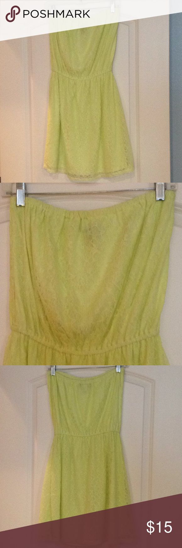 Fun and flirty lace strapless slip on dress! Perfect for spring break beach weather or night out! Color is lime green; slip dress with lace overlay by Victoria's Secret. Elastic around waist and top. Size M, I wore as an 8. The dark area around the neck is the VS tag showing thru the material. There is one area on the back of the dress where the lace is slightly dis colored. I didn't notice until photographing. Not noticeable especially being on the back. PINK Victoria's Secret Dresses…