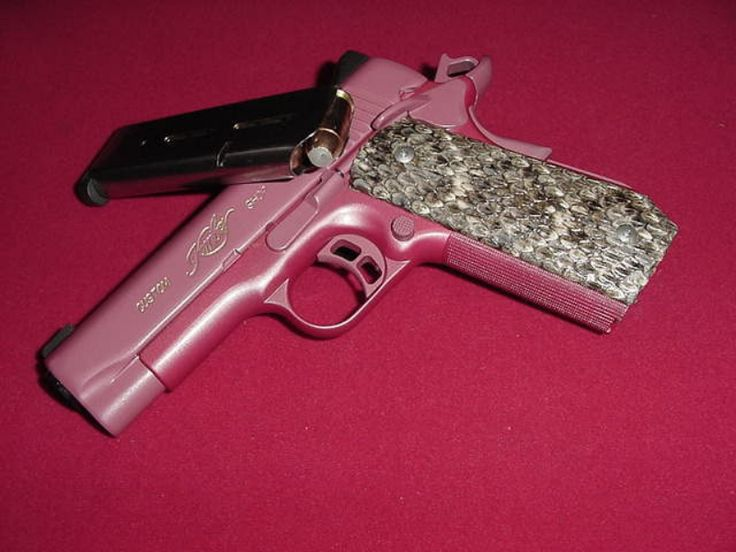 Kimber 45 anodized in pink with pearl coating and snakeskin. Gotta get one 1) its pink 2) need a new gun 3) its a Kimber and Im Kimber hahaha