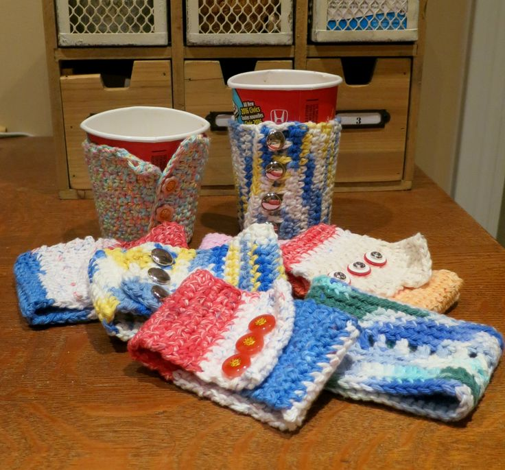Knitted sideways, these cup cozies' old buttons were sewn on closer to the edge at the top so that there is ease when inserting the cup.  Craft cotton was used.