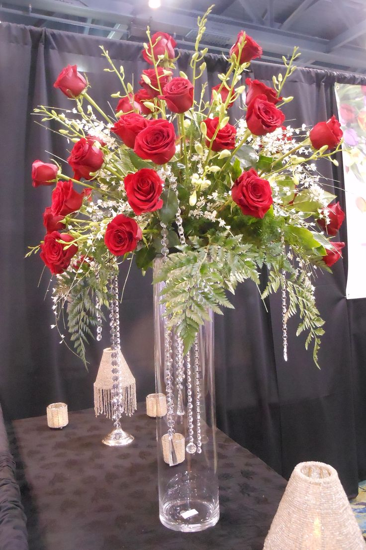 red rose arrangement on a tall glass vase with hanging crystals. http://thebloomingidea.blogspot.com