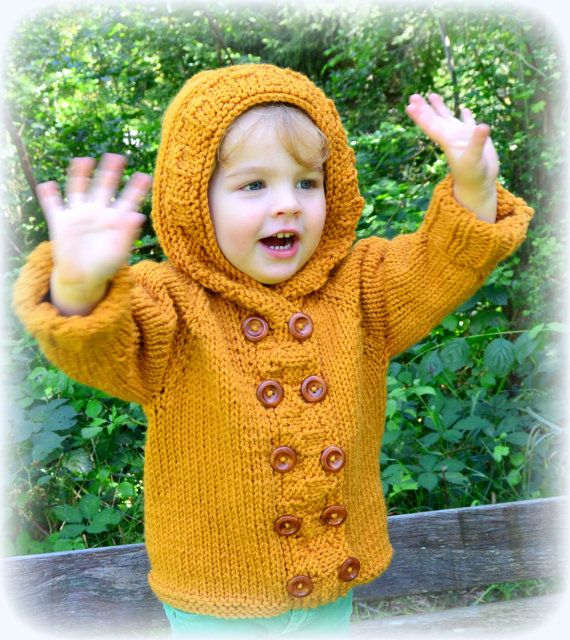 Hand knitted chunky weight hooded coat made to order in a dark yellow color or in 21 other colors. The coat is very soft and warm, available in the sizes 0-3, 3-6, 6-12, 12-18 and 18-24 months, and 2T, 3T and 4T and 5T and 6T. Its made of a blend of pure merino wool yarn and baby acrylic yarn from a very soft, warm and comfy quality. Warmth because of the wool, and washability because of the acrylic part. The coat has a button closure front, with nice wooden buttons. Perfect for layering for…