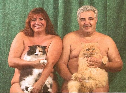people covering their naked bodies...with cats