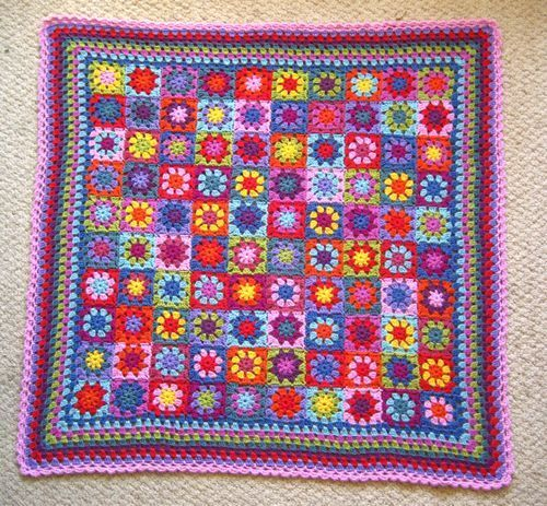 So lovely! The granny square to make this blanket you can find here: http://attic24.typepad.com/weblog/summer-garden-granny-square.html