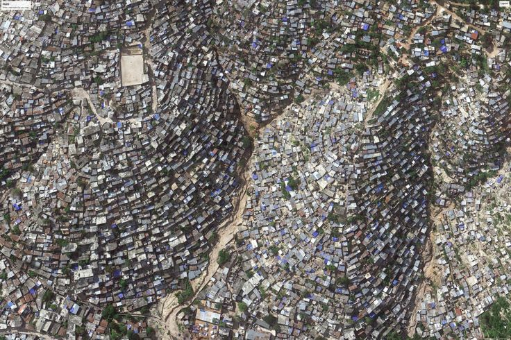 Slum-dwelling residents of Port-au-Prince, Haiti (population 4 million, density 50,000/mile) face bleak living conditions in the Western Hemisphere's poorest country; Google Earth/2014 Digital Globe.