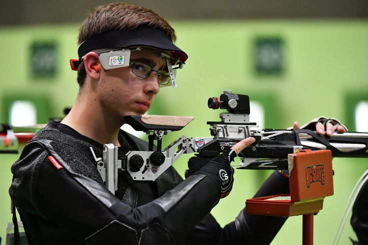 . US Lucas Kozeniesky competes during the 10m Air Rifle Men\'s at the Olympic Shooting Centre in Rio de Janeiro on August 8, 2016, during the Rio 2016 Olympic Games. (PASCAL GUYOT/AFP/Getty Images)
