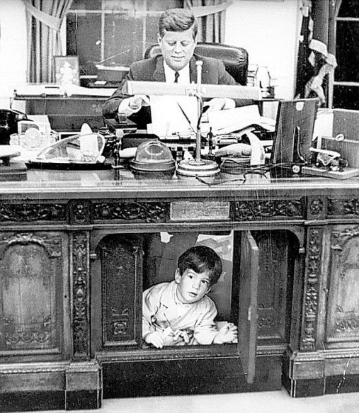 John F. Kennedy Jnr. under the Resolute Desk