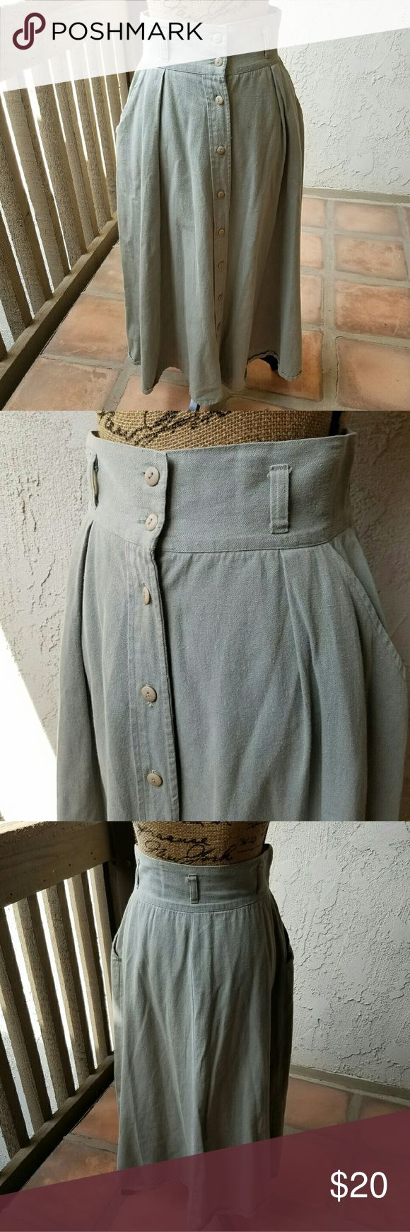 """Light khaki denim skirt button front Pale khaki colored denim skirt buttons down the front... super soft material... 100 % cotton.... side pockets in the front ...the 2nd buttonhole  at the waist  is slightly frayed,but you don't see it when it's buttoned.. the length is somewhere between mini & maxi, measures approximately 28"""" around the waist and approx. 34"""" from the waistband to the hem....tu10... swat Skirts A-Line or Full"""