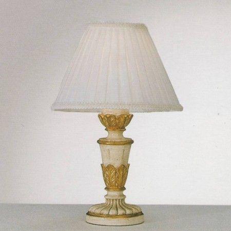 Lampada da tavolo Firenze Corpo luce in resina. Bracci e foglie in metallo modellato artigianalmente. Decorato a mano con foglia d'oro e antichizzato.