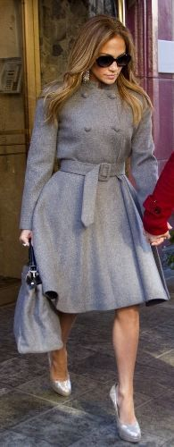 Jennifer Lopez's gray handbag, plaid pants, gray plaid fringe scarf, and buckle boots  she wore in New York on February 1, 2012