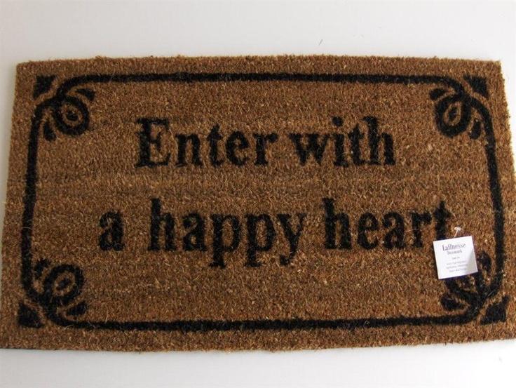 """Dörrmatta från Lafinesse med texten """"Enter with a happy heart"""".149:-"""