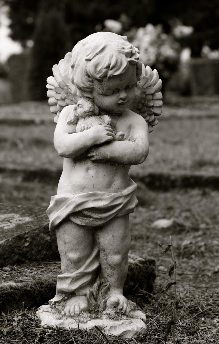 Garden Statue, Cherub Angel, Little boy holding his bunny, 5x7 black and white photograph, Nursery Decorations. $20.00, via Etsy.