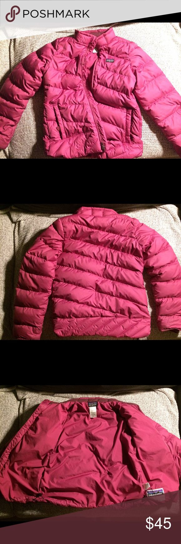 Girls Patagonia puffer Great condition, very warm puffer jacket, size large (12) in girls, drawcord at hem to keep cold air out. There are a few spots on the one sleeve - 3 small hard to see shadowy spots circled in white in the photos that I wanted to disclose anyway and one small, light pen/pencil mark. Patagonia Jackets & Coats Puffers