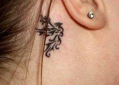 exemple tatouage phoenix tribal femme derriere l oreille  http://tatouagefemme.eu/tatouage-phoenix/