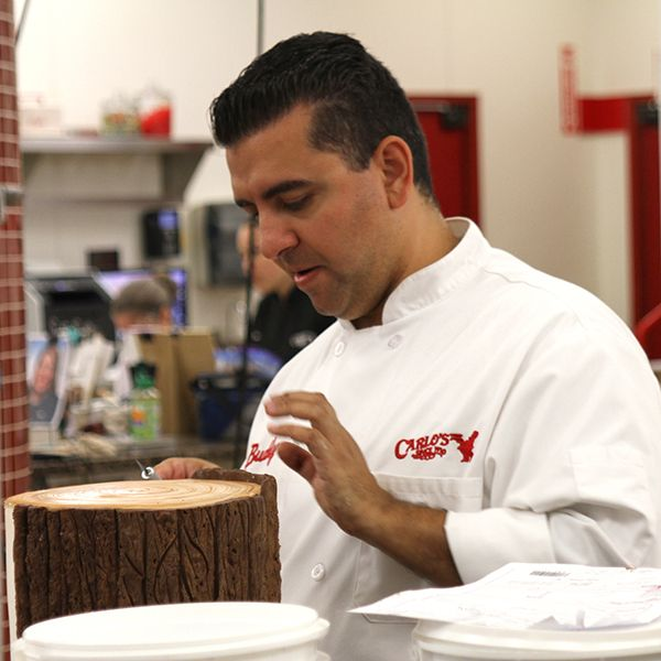 Buddy putting the icing on the tree cake. #CakeBoss
