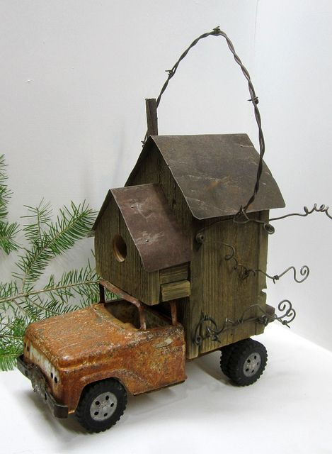vintage toy truck refashioned into a  birdhouse..