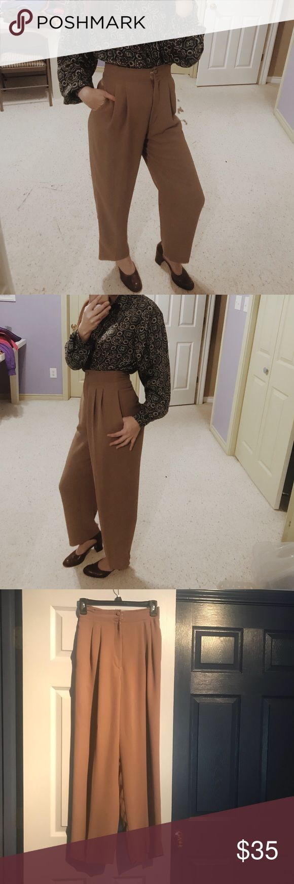 High waisted dress pants Super cute! Definitely a style statement! Pockets on both sides. Missing one button on the top but isn't really noticeable and can be easily fixed. Not UO, labeled that for exposure. Urban Outfitters Pants